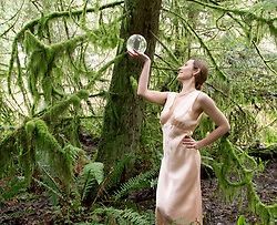Mature woman looking into crystal ball in forest (Credit Image: © Image Source/Pete Saloutos/Image Source/ZUMAPRESS.com)