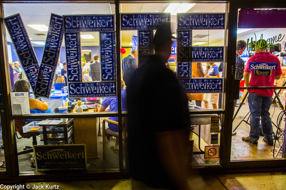 28 AUGUST 2012 - PHOENIX, AZ:  A person walks into Rep. David Schweikert's (R-AZ) victory party Tuesday night. Schweikert faced Congressman Ben Quayle in what was the hardest Republican primary election in Arizona in 2012. Both were incumbent Republican freshmen elected to Congress from neighboring districts in 2010. They ended up in the same district at the end of the redistricting process and faced off against each other in the primary to represent Arizona's 6th Congressional District, which is made up of Scottsdale, Paradise Valley and parts of Phoenix. The district is solidly Republican and the winner of the primary is widely expected to win November's general election. Both are conservative Republicans with Tea Party backing.   PHOTO BY JACK KURTZ