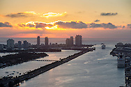 Miami Beach at dawn, aerial with Government Cut and cruise ships, looking east with South Pointe and MacArthur Causeway and Port of Miami