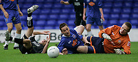 Photo: Dave Howarth.<br /> Stockport County v Swansea City. The FA Cup.<br /> 05/11/2005.  Swansea's Leon Britton tries for goal but is blocked by Stockport's Mark robinson and Keeper James Spencer