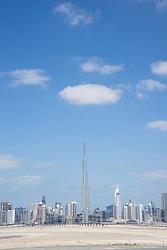 Skyline of Dubai from the desert in United Arab Emirates