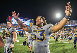 Sep 11, 2021; Morgantown, West Virginia, USA; West Virginia Mountaineers offensive lineman Jordan White (53) celebrates with teammates after defeating the Long Island Sharks at Mountaineer Field at Milan Puskar Stadium. Mandatory Credit: Ben Queen-USA TODAY Sports