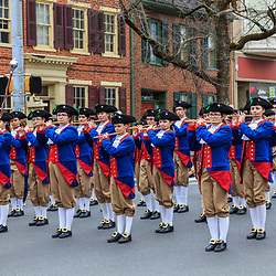 York, PA / USA - March 12, 2016: Early American colonial reenactors march in the annual Saint Patrick's Day Parade.