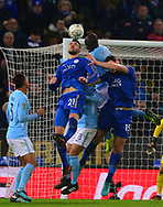 Vicente Iborra of Leicester city, Harry Maguire of Leicester city, Ilkay Gundogan of Manchester City and Yaya Toure of Manchester City all jump for the ball .Carabao Cup quarter final match, Leicester City v Manchester City at the King Power Stadium in Leicester, Leicestershire on Tuesday 19th December 2017.<br /> pic by Bradley Collyer, Andrew Orchard sports photography.