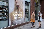 Poster which reads we cant wait to see you again on 10th August 2021 in London, United Kingdom. The poster is outside a hardressing school, the Goldwell Academy.