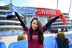 A Manchester City fan outside the stadium ahead of the match