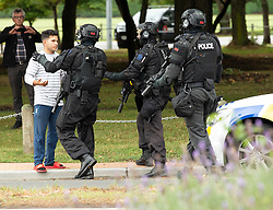 March 15, 2019 - Christchurch, Canterbury, New Zealand - AOS (Armed Offenders Squad) tactical police push back members of the public following a shooting resulting in multiple fatalities and injuries at the Masjid Al Noor Mosque, Deans Avenue, Christchurch, New Zealand. At least 49 people were killed and 20 seriously injured in mass shootings at two mosques in the New Zealand city of Christchurch. 48 people, including young children with gunshot wounds, were taken to hospital. Three people were arrested in connection with the shootings. (Credit Image: © Martin Hunter/SNPA via ZUMA Wire)