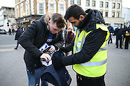 Security staff checking supporters bags outside Stamford Bridge before k/o. Premier league match, Chelsea v Tottenham Hotspur at Stamford Bridge in London on Saturday 26th November 2016.<br /> pic by John Patrick Fletcher, Andrew Orchard sports photography.