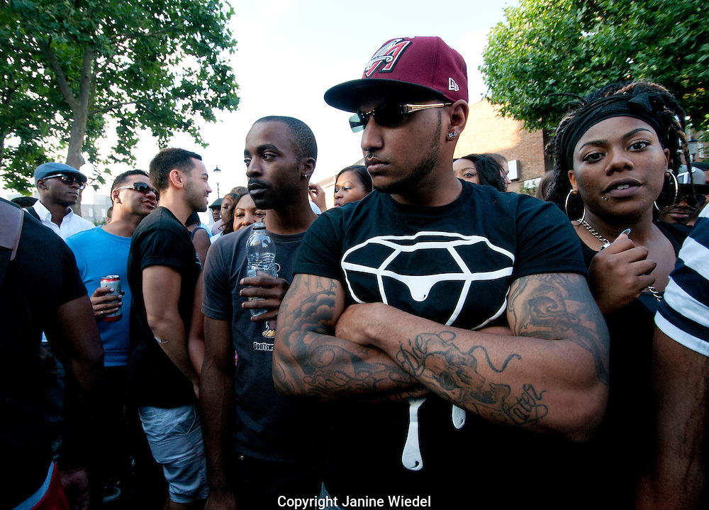 man with tattoos in crowd at Notting Hill festival