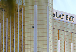 Oct 2, 2017 - Las Vegas, Nevada, U.S. - A broken window is shown on the east-facing facade of Mandalay Bay hotel-casino. A mass shooting occurred late Sunday evening at the music festival. (Credit Image: © Ronda Churchill via ZUMA Wire)