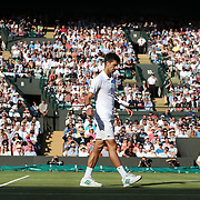 LONDON, ENGLAND - JULY 12:  Novak Djokovic of Serbia retires injured during his match against Tomas Berdych of the Czech Republic in the Mens' Singles Quarter Final match on Court One during the Wimbledon Lawn Tennis Championships at the All England Lawn Tennis and Croquet Club at Wimbledon on July 12, 2017 in London, England. (Photo by Tim Clayton/Corbis via Getty Images)