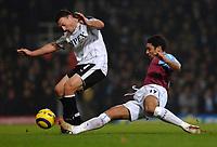 Photo: Daniel Hambury.<br />West Ham United v Fulham. The Barclays Premiership. 23/01/2006.<br />West Ham's Hayden Mullins tackles Fulham's Steed Malbranque.