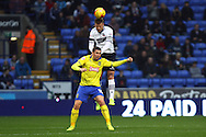 Matthew Mills of Bolton Wanderers jumps above Grant Holt of Huddersfield Town to win the ball. Skybet football league championship match, Bolton Wanderers v Huddersfield Town at the Macron stadium in Bolton, Lancs on Saturday 29th November 2014.<br /> pic by Chris Stading, Andrew Orchard sports photography.