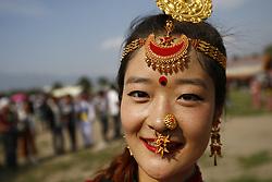 May 20, 2017 - Kathmandu, Nepal - A Nepalese woman from ethnic Kirat community dressed in customary attire looks on while performing traditional Sakela dance during their cultural Sakela dancing festival in Kathmandu, Nepal on Saturday, May 20, 2017. (Credit Image: © Skanda Gautam via ZUMA Wire)