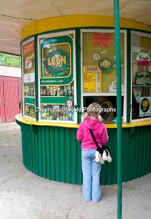 Polish girl purchasing ice cream at a kiosk.  Spala   Poland