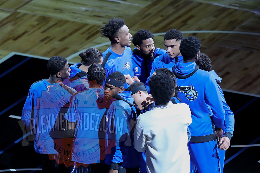 ORLANDO, FL - APRIL 07: The Orlando Magic huddle up prior to a game against the Washington Wizards at Amway Center on April 7, 2021 in Orlando, Florida. NOTE TO USER: User expressly acknowledges and agrees that, by downloading and or using this photograph, User is consenting to the terms and conditions of the Getty Images License Agreement. (Photo by Alex Menendez/Getty Images)*** Local Caption ***