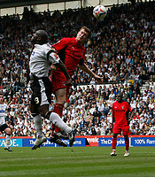 Photo: Steve Bond.<br />Derby County v Coventry City. Coca Cola Championship. 09/04/2007. Darren Moore (L) in an aerial challenge