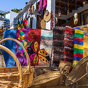 Baskets, rugs and other crafts for sale at a market in Alpujarra de la Sierra (Almeria, Andalucia, Spain).
