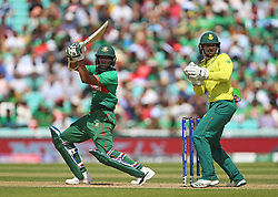 South Africa's Quinton de Kock (right) and Bangladesh's Shakib Al Hasan during the ICC Cricket World Cup group stage match at The Oval, London.