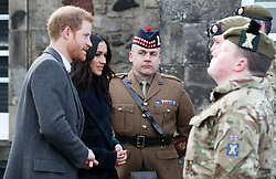 Prince Harry and Meghan Markle meet the gunners before the firing of the One o'clock gun at Edinburgh Castle, during their visit to Scotland.