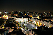 Praça D. Pedro IV, known as Rossio square and part of the Baixa district, seen at night from the walkway at the top of Elevador de Sta. Justa, in central Lisbon.