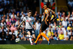 Ryan Mason of Tottenham Hotspur is tackled by Tom Huddlestone of Hull City - Photo mandatory by-line: Rogan Thomson/JMP - 07966 386802 - 16/05/2015 - SPORT - FOOTBALL - London, England - White Hart Lane - Tottenham Hotspur v Hull City - Barclays Premier League.