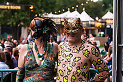 Brooklyn, NY - 15 July 2017. The BRIC Celebrate Brooklyn! Festival summer concert series featured a post-Bastille Day bill of the Louisiana bilingual band Sweet Crude and French songwriter and stylist Ben L'Oncle Soul. Two audience members decked out in a peacock print dress and jungle cat body paint.