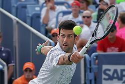 August 19, 2018 - Mason, Ohio, USA - Novak Djokovic (SRB) reaches to return a shot during Sunday's final round of the Western and Southern Open at the Lindner Family Tennis Center, Mason, Oh. (Credit Image: © Scott Stuart via ZUMA Wire)