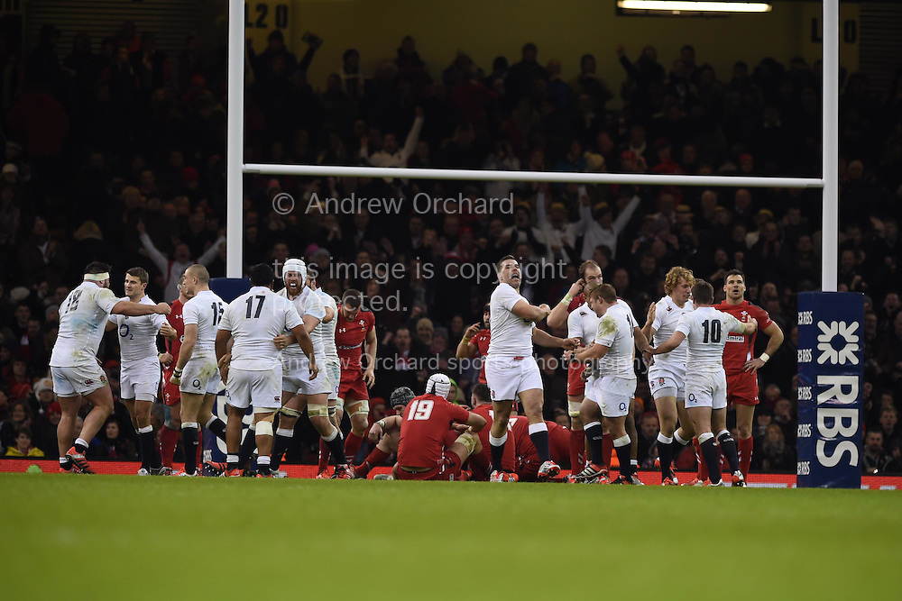 England players celebrate their win as the final whistle goes. RBS Six nations championship 2015, Wales v England at the Millennium Stadium in Cardiff, South Wales on Friday 6th  Feb 2015. pic by Andrew Orchard, Andrew Orchard sports photography.