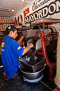 Workers use grinding and mixing machines used to mix chocolate and spices into mole in Oaxaca, Mexico.