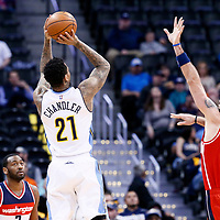 08 March 2017: Denver Nuggets forward Wilson Chandler (21) takes a jump shot o er Washington Wizards center Marcin Gortat (13) during the Washington Wizards 123-113 victory over the Denver Nuggets, at the Pepsi Center, Denver, Colorado, USA.