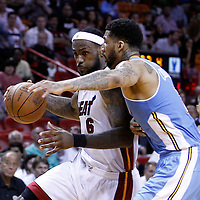 19 March 2011: Miami Heat small forward LeBron James (6) drives past Denver Nuggets small forward Wilson Chandler (21) during the Miami Heat 103-98 victory over the Denver Nuggets at the AmericanAirlines Arena, Miami, Florida, USA.