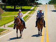 04 JULY 2020 - RUNNELLS, IOWA: People on horseback bring up the end of the 4th of July tractor parade in Runnells, a small community about 25 miles from Des Moines. Most of the Independence Day parades in central Iowa were cancelled because of the COVID-19 (Coronavirus) pandemic. People in Runnells made the decision to go ahead with their parade, the first 4th of July parade in the town in recent memory. Most of the people in the parade were farmers, who drove their tractors through the town.    PHOTO BY JACK KURTZ