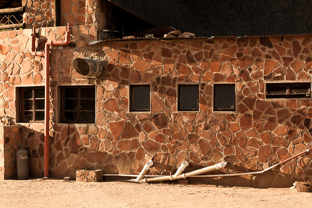 Typical architectural textures in South Africa tourism spots.The stone work reminds me of a Giraffe.