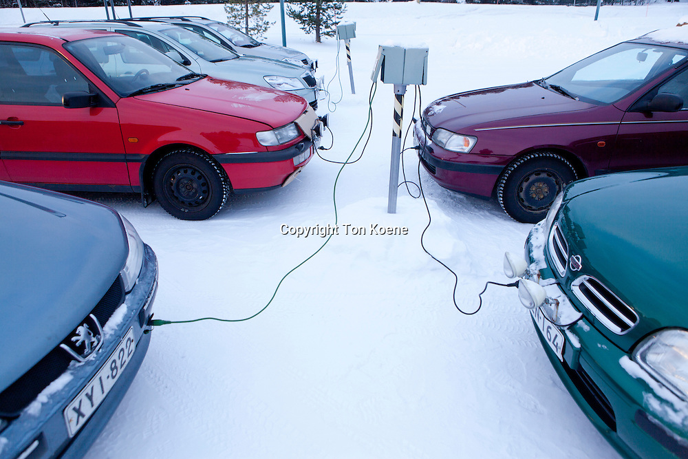 cars being heated by electricty in Finland