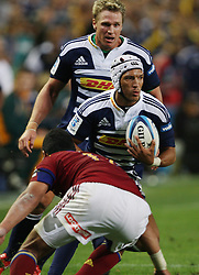 Gio Aplon steps inside the defense of Siale Piutau with Jean de Villiers in support during the Super Rugby (Super 15) fixture between the DHL Stormers and the Highlanders held at DHL Newlands Stadium in Cape Town, South Africa on 11 March 2011. Photo by Jacques Rossouw/SPORTZPICS