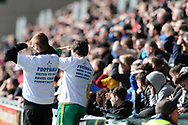 Ball boys look on wearing special 'football united to beat bowel cancer' t shirts. EFL Skybet football league two match, Newport county v Crawley Town at Rodney Parade in Newport, South Wales on Saturday 1st April 2017.<br /> pic by Andrew Orchard, Andrew Orchard sports photography.
