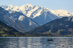 THEMENBILD - ein Angler mit seinem Boot am Zeller See vor der Bergkulisse der Hohen Tauern, aufgenommen am 30. April 2016, am Zeller See, Zell am See, Oesterreich // an angler with his boat on Lake Zell ahead of the mountain scenery of the Hohe Tauern, Zell am See, Austria on 2016/04/30. EXPA Pictures © 2016, PhotoCredit: EXPA/ JFK