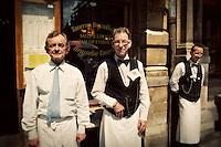 Portrait of waiters outside La Brouette restaurant in Grand Place, Brussels, Belgium