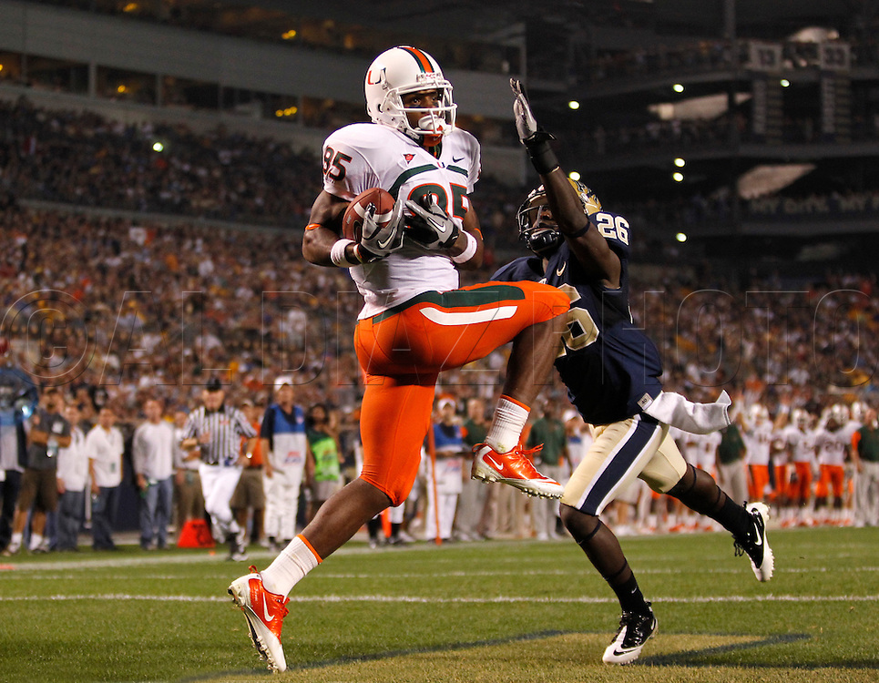 Miami Hurricanes wide receiver Leonard Hankerson (85) scores a third quarter touchdown pass from quarterback Jacory Harris (12). defending is Pittsburgh Panthers cornerback Ricky Gary (26) during The University of Miami  vs The University of Pittsburgh Panthers at Heinz Field in Pittsburgh, PA, on Thursday, September 23, 2010.