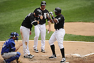 CHICAGO - JULY 11:  Andruw Jones #25 is greeted by A.J. Pierzynski #12 and Mark Kotsay #7 of the Chicago White Sox at home plate after hitting Jones hit his 400th career home run off of Anthony Lerew #54 of the Kansas City Royals in the third inning on July 11, 2010 at U.S. Cellular Field in Chicago, Illinois.  The White Sox defeated the Royals 15-5.  (Photo by Ron Vesely)Lerew;Mark Kotsay;A.J. Pierzynski