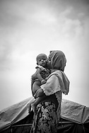 Shamsur Nahar, age 25, kisses her one-year-old daughter Yasmin Ara. From Myanmar's Rakhine State but now living in Kutupalong refugee camp in Bangladesh, they are part of what the U.N. has called the world's fastest developing refugee crisis. Hundreds of thousands of Rohingya have fled Myanmar since August. (October 29, 2017)