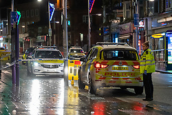 © Licensed to London News Pictures. 13/12/2020. London, UK. Police vehicles inside the cordon on Station Road. Police were called at approximately 19:15GMT on Sunday, 13 December to reports of a stabbing in St Anns Road, Harrow. Officers and London Ambulance Service attended. <br /> A man – believed aged in his 20s – was found suffering stab injuries; despite the efforts of the emergency services he was pronounced dead at the scene. Two further males – both believed aged in their late teens – also suffered stab injuries. Photo credit: Peter Manning/LNP