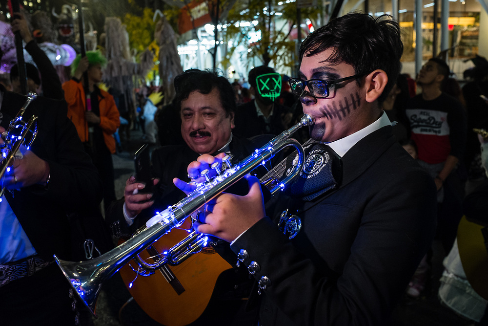 New York, NY - 31 October 2019. the annual Greenwich Village Halloween Parade along Manhattan's 6th Avenue. A trumpeter in a mariachi band.
