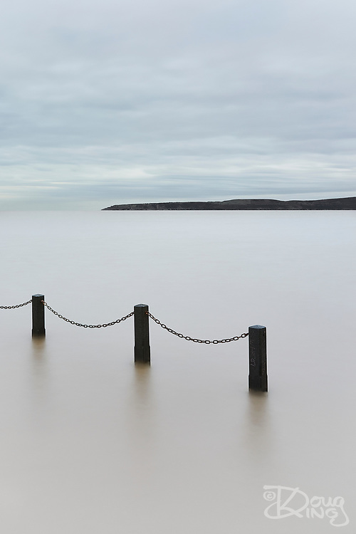"""A quick trip down to Weston Supermare saw me intending to shoot the classic image of the tide just covering the causeway at the marine lake. However the muted sky and muddy waters attracted me to something entirely more minimalist.<br /> <br /> Limited Edition of 30<br /> Fine Art Print 18"""" x 12""""<br /> £100 + Postage"""