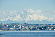 Mt. Rainier rises in the distance over Lake Washington.