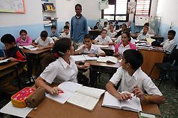 Black male teacher in classroom at Carlos J Finlay secondary school; Havana; Cuba,
