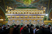 Pilgrims pay homage at the Grave of Sukayna in Sayyidah Ruqayya Mosque, a shrine located in Damascus, Syria, that contains the grave of Sukayna (née Ruqayyah), the infant daughter of Husayn ibn 'Alī. Built in 1985 in a modern style of Iranian architecture.