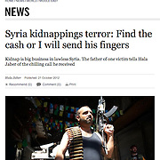 "Tearsheet of ""Syria: FSA fighters"" published in The Sunday Times"