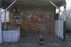 October 25, 2016 - Calais, Nord-Pas-de-Calais-Picardie, France - A fire extinguisher is all that's left on the porch of this abandoned shop. A little less than 2000 refugees are expected to be disbursed from the Jungle to different areas in France on the 2nd day of the eviction of the Jungle in Calais. It is also expected that the demolition of the camp will start. (Credit Image: © Michael Debets/Pacific Press via ZUMA Wire)